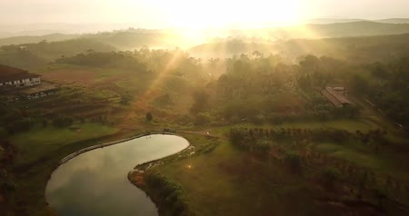 назад : Beautiful aerial view of palm oil plantation and lake on sunrise time at Sukabumi, West Java, Indonesia. Shot in 4k resolution