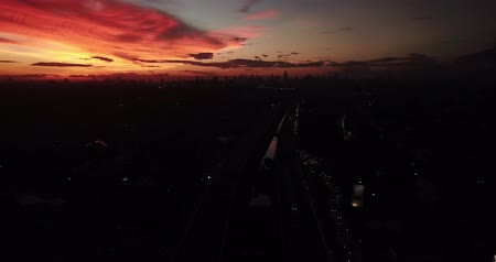 passagem elevada : Beautiful aerial view of sunset time from a drone in Jakarta capital city, Indonesia. Shot in 4k resolution