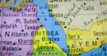 térképészet : JAKARTA - Indonesia. February 21, 2018: Closeup of a globe with Ethiopia country map. Ethiopia is a country located in the Horn of Africa. Shot in 4k resolution
