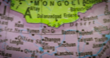 térképészet : JAKARTA - Indonesia. February 21, 2018: Closeup of Mongolia country map on the globe. Mongolia is a landlocked unitary sovereign state in East Asia. Shot in 4k resolution