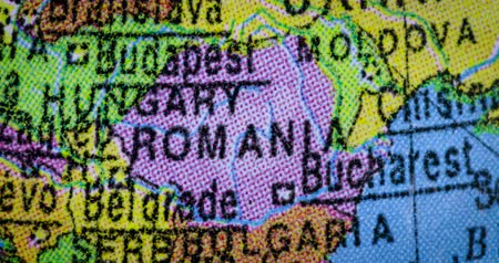 atlasz : JAKARTA - Indonesia. February 21, 2018: Closeup of country map of Romania region on the globe. Romania is a southeastern European country. Shot in 4k resolution Stock mozgókép