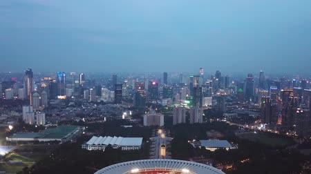 bung : Beautiful aerial Jakarta city view with Gelora Bung Karno Stadium and skyscrapers at night, shot in 4k resolution