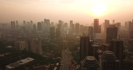sudirman : JAKARTA, Indonesia - May 22, 2018: Beautiful aerial view of Sudirman CBD with skyscrapers and highway on sunrise time in misty morning. Shot in 4k resolution