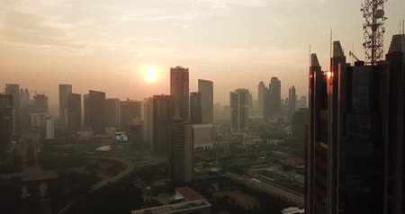 central business district : JAKARTA, Indonesia - May 22, 2018: Beautiful aerial sunrise view in Jakarta city near the Semanggi central business district on misty morning. Shot in 4k resolution