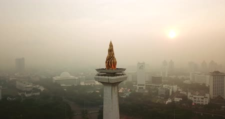 obelisk : JAKARTA, Indonesia - May 30, 2018: Beautiful aerial view of National Monument Jakarta peak on misty morning. Shot in 4k resolution from a drone