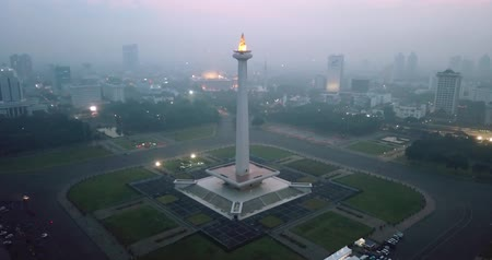 obelisk : JAKARTA, Indonesia - May 30, 2018: Beautiful aerial landscape of National Monument in Jakarta downtown. Shot in 4k resolution from a drone
