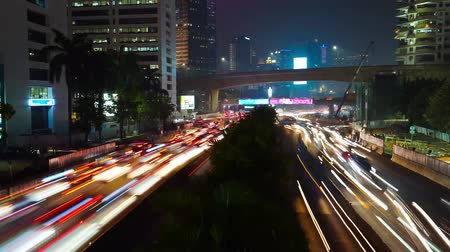 central business district : JAKARTA, Indonesia - June 22, 2018: Time lapse footage of traffic jam at night with blurred lights car in Jakarta downtown. Shot in 4k resolution