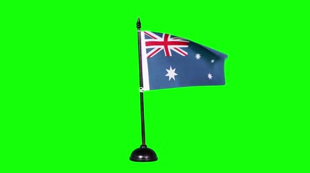 깃대 : Flag of Australia waving on green screen background in the studio