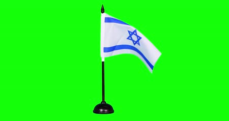 mastro de bandeira : Slow motion of Israel flag flying on green screen background in the studio Vídeos