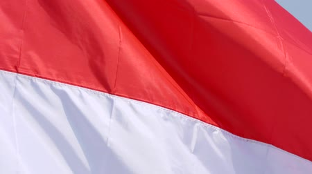 augusto : Slow motion of national flag of Indonesia country flying outdoor as a symbol of freedom and independence day