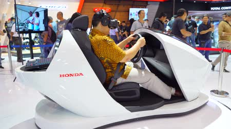 prospect : Tangerang, Indonesia - August 08, 2018: Male visitor wearing VR glasses while trying Honda Prospect Motor at Gaikindo Indonesia International Auto Show. Shot in 4k resolution