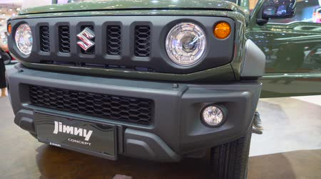 nárazník : Tangerang, Indonesia - August 08, 2018: Closeup of front bumper of Suzuki Jimny car at Gaikindo Indonesia International Auto Show. Shot in 4k resolution Dostupné videozáznamy