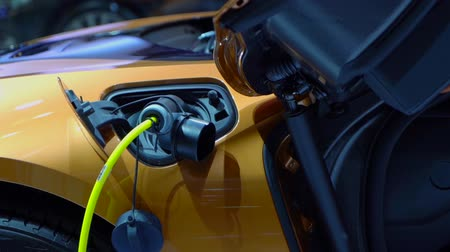 sofisticado : Tangerang, Indonesia - August 08, 2018: Closeup of BMW i8 Roadster car with electric charger in Gaikindo Indonesia International Auto Show Stock Footage