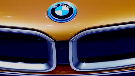 electric vehicle : Tangerang, Indonesia - August 08, 2018: Front view of BMW i8 Roadster car with the BMW logo displayed in Gaikindo Indonesia International Auto Show Stock Footage
