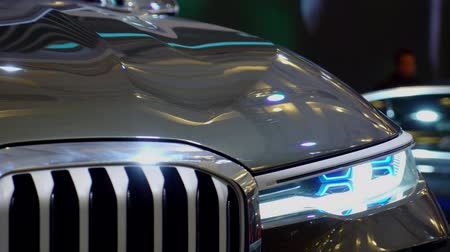sofisticado : Tangerang, Indonesia - August 08, 2018: Headlamp and shiny exterior of BMW Concept X7 iPerformance car showed at Gaikindo Indonesia International Auto Show. Shot in 4k resolution Stock Footage