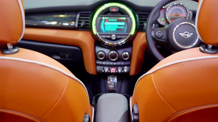 sofisticado : Tangerang, Indonesia - August 08, 2018: Mini Cooper car interior looks luxury displayed in Gaikindo Indonesia International Auto Show. Shot in 4k resolution Stock Footage