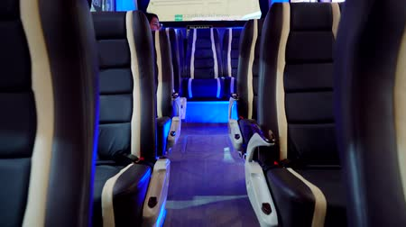 přihrádka : Tangerang, Indonesia - August 08, 2018: Comfortable chairs of new modern bus showed in Gaikindo Indonesia International Auto Show. Shot in 4k resolution