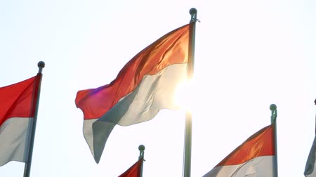 zászlórúd : Indonesia flags flying on the pole with sunlight background. Shot outdoors in 4k resolution