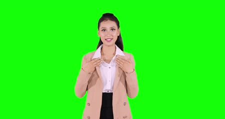 speach : Beautiful young businesswoman giving a presentation or gesturing as a speaker in conference or meeting, shot in 4k resolution with green screen background