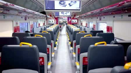 ulička : JAKARTA, Indonesia - September 20, 2018: Quiet corridor and seats of Soekarno-Hatta Airport Train going to the airport. Shot in 4k resolution