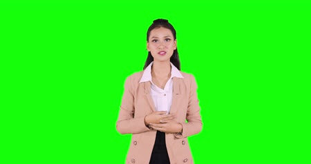 speach : Young Asian business woman with speaking gesture in a conference or a seminar. Shot in 4k resolution with green screen background