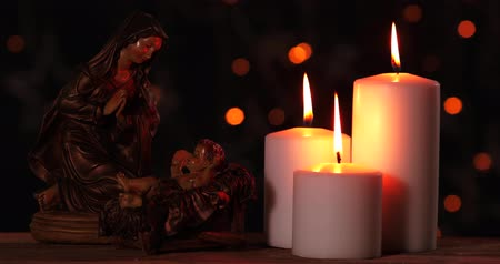 soška : Christmas nativity scene with virgin Mary and glowing candles. Shot in 4k resolution