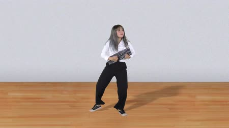 yetenekli : Happy business woman dancing while playing a computer keyboard as a guitar. Shot in 4k resolution