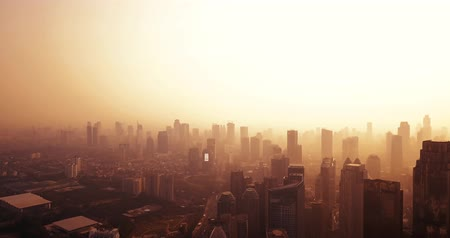 sudirman : JAKARTA, Indonesia - October 04, 2018: Aerial view of silhouette skyscrapers in Jakarta downtown on misty morning. Shot in 4k resolution