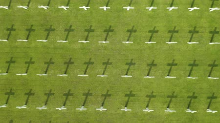 veteran's day : Aerial landscape of Dutch war cemetery with rows of crosses at Ereveld Menteng Pulo, Jakarta, Indonesia. Shot in 4k resolution Stock Footage