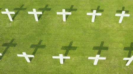 emlékeztető : JAKARTA, Indonesia - October 09, 2018: Aerial view of Dutch war cemetery with crosses at Ereveld Menteng Pulo, Jakarta, Indonesia. Shot in 4k resolution