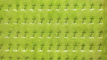 могила : Top view of Ereveld Menteng Pulo or Dutch war cemetery with rows of crosses and green grass in Jakarta, Indonesia.