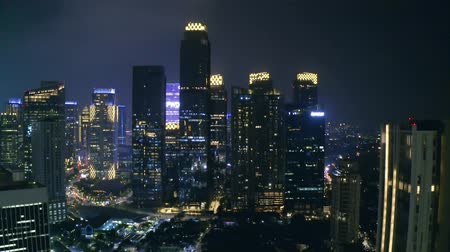 sudirman : JAKARTA, Indonesia - October 10, 2018: Beautiful aerial scenery of modern skyscrapers in Sudirman Central Business District at night. Shot in 4k resolution