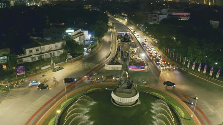sudirman : JAKARTA, Indonesia - October 10, 2018: Aerial landscape of Senayan Roundabout with Patung Pemuda Membangun or Youth Monument and night traffic in Jakarta. Shot in 4k resolution