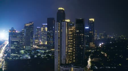 sudirman : JAKARTA, Indonesia - October 10, 2018: Beautiful aerial view of skyscrapers at night in Sudirman Central Business District, Jakarta, Indonesia. Shot in 4k resolution