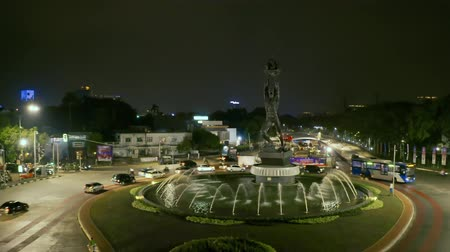 sudirman : JAKARTA, Indonesia - October 10, 2018: Aerial view of Patung Pemuda Membangung or Youth Advancement Monument at night in Senayan Roundabout. Shot in 4k resolution Stock Footage