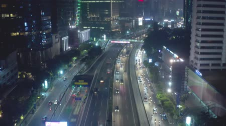 inner : JAKARTA, Indonesia - October 16, 2018: Aerial view of tollway in Jakarta city at night with light trails of vehicles. Shot in 4k resolution Stock Footage