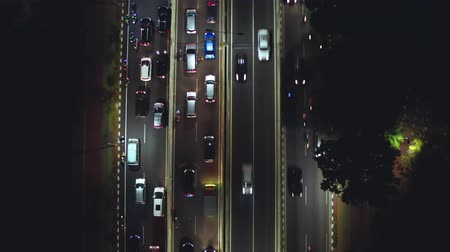 passagem elevada : JAKARTA, Indonesia - October 23, 2018: Aerial shot of night traffic jam with vehicles moving slowly on the Casablanca street in Jakarta, Indonesia. Shot in 4k resolution