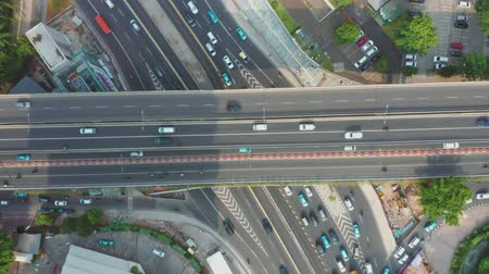 sudirman : Top view of heavy traffic on the Sudirman highway in the Central Business District of Jakarta. Shot in 4k resolution