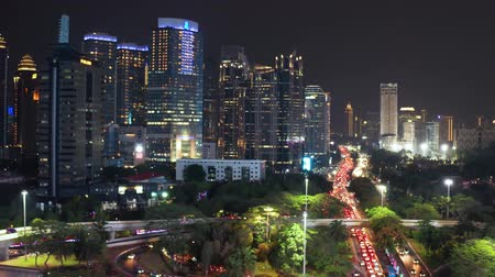 central business district : JAKARTA, Indonesia - November 06, 2018: Aerial view of Jakarta downtown with modern office buildings and Semanggi highway interchange at night. Shot in 4k resolution