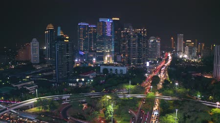 interchange : JAKARTA, Indonesia - November 06, 2018: Aerial landscape of Semanggi highway interchange and skyscrapers with traffic jam at nighttime in Jakarta city. Shot in 4k resolution