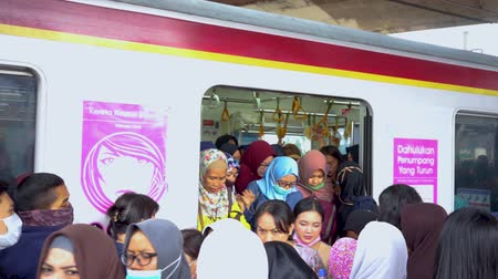 erkeklere özel : JAKARTA, Indonesia - November 13, 2018: Crowded female passengers get off from the commuter train special for women in the train station