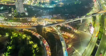 indonesia : JAKARTA, Indonesia - November 13, 2018: Hyperlapse of highway interchange with traffic jam at night on rush hour in Jakarta, Indonesia. Shot in 4k resolution