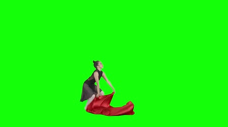 gracioso : Young Asian woman dancing ballet with a red cloth. Shot in the studio with green screen background