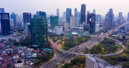 sudirman : JAKARTA, Indonesia - November 21, 2018: Hyperlapse of Semanggi highway intersection and modern office buildings at dust time in Jakarta city. Shot in 4k resolution Stock Footage