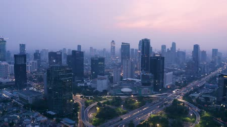 sudirman : JAKARTA, Indonesia - November 26, 2018: Beautiful aerial view of Jakarta skyline with skyscrapers and highway traffic on the Semanggi bridge at dawn. Shot in 4k resolution