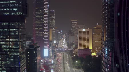 sudirman : JAKARTA, Indonesia - November 26, 2018: Beautiful aerial view of skyscrapers and night traffic on Sudirman street in Jakarta downtown. Shot in 4k resolution