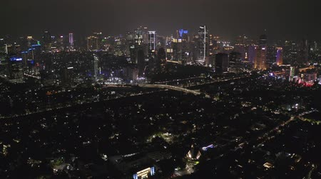 митрополит : JAKARTA, Indonesia - December 14, 2018: Aerial panorama of Jakarta downtown with skyscrapers and night lights. Shot in 4k resolution Стоковые видеозаписи