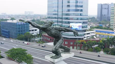 orta hava : JAKARTA, Indonesia - December 12, 2018: Aerial view of Dirgantara statue also known as Tugu Pancoran Monument in Jakarta city. Shot in 4k resolution