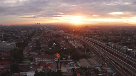 toll : JAKARTA, Indonesia - January 02, 2019: Beautiful aerial view of Becakayu toll road at sunrise time in Jakarta, Indonesia. Shot in 4k resolution