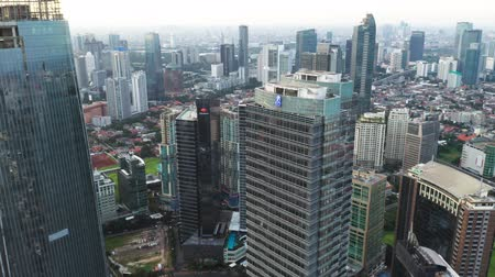 sudirman : JAKARTA, Indonesia - January 02, 2019: Beautiful aerial scenery of modern office buildings in business district. Shot in 4k resolution